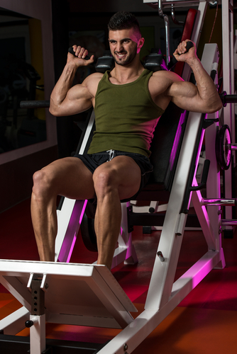 fit guy doing leg press