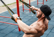 fit muscular guy doing pull up exercise