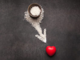 salt forming an arrow pointing on rubber heart