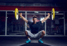 fit guy squat overhead barbell lift