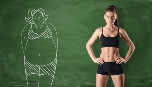 fit woman beside chalk drawing of obese woman weight loss concept