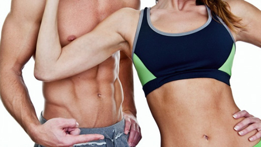 fit couple showing abs and flat stomach