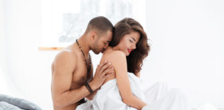 couple getting intimate in bed