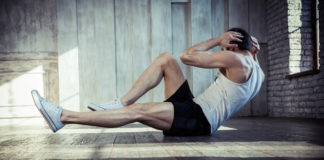 man doing core exercise crunches