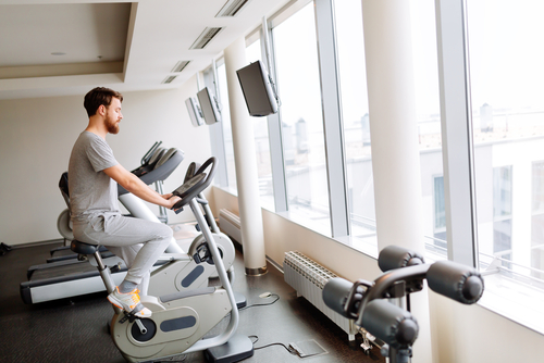 man cycling on stationary bike