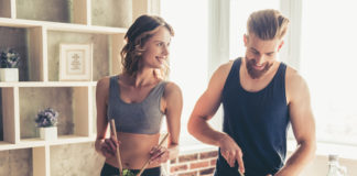 fitness couple preparing meal together