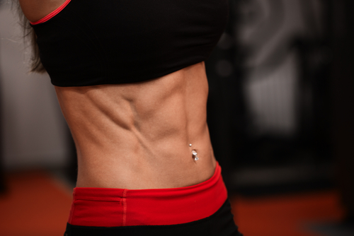 fit woman flat stomach abs