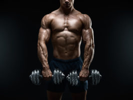 ripped guy lifting heavy weights