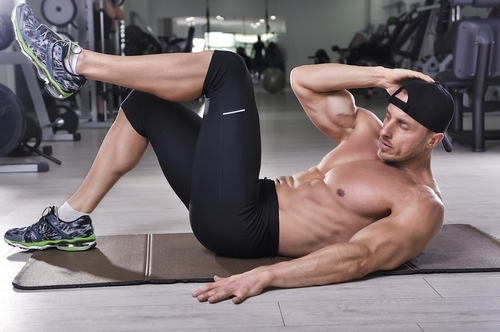 fit guy doing crunches
