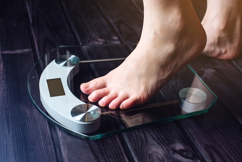 stepping on weighing scale