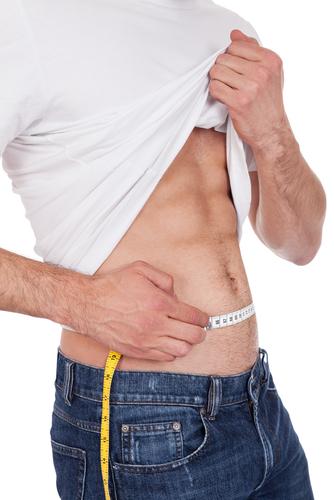 fit man measuring waist