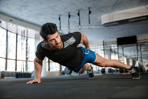 fit guy doing one hand push ups reaping Progentra benefits