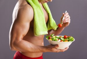 fit man eating salad have healthier life