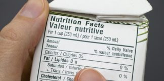 reading nutrition fact label on carton