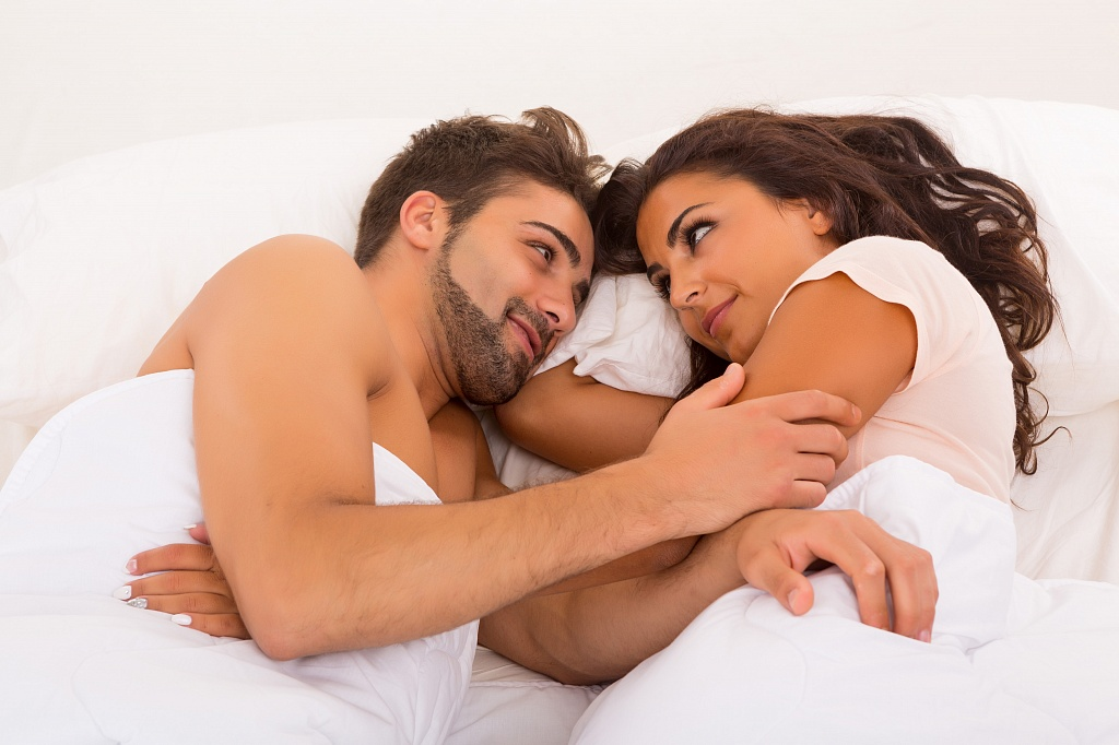 sweet couple lying in bed