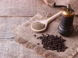 whole and ground black pepper with mill