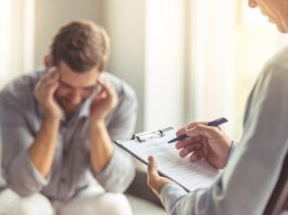 psychologist counselling a depressed man