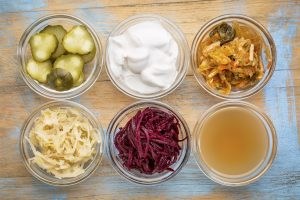 probiotic food in bowls, yogurt, kimchi, sauerkraut, pickles, miso