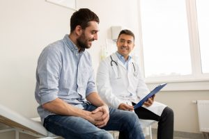 man consulting with doctor about health