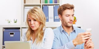 couple privately browsing social separately