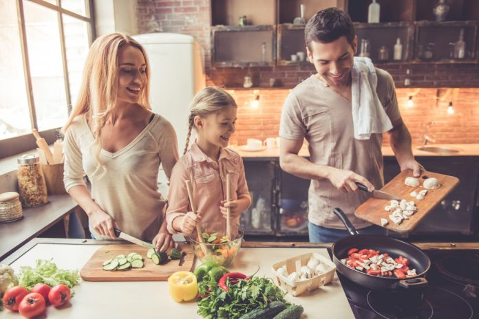 family preparing healthy meal together