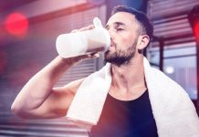 fit man drinking protein shake