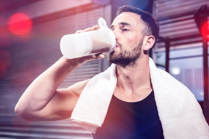 fit man who uses Progentra drinking protein shake