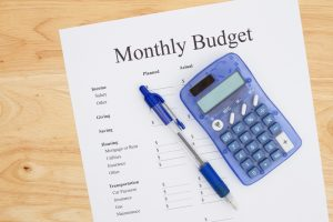 calculator and monthly budget sheet