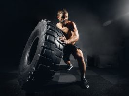 man lifting tire intense circuit exercise after taking Progentra
