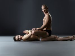 naked couple meditating and doing yoga together with man who takes Progentra on top