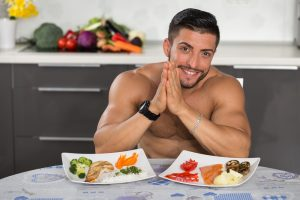 fit guy who takes Progentra having a healthy meal