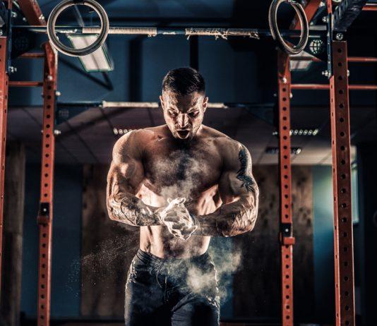 buff man preparing to workout in gym