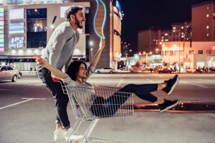 a guy pulling her girl on a cart