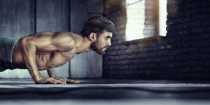 fit muscular guy doing push ups