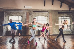 man joins a group dance exercise class