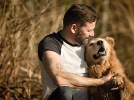 man and dog bonding