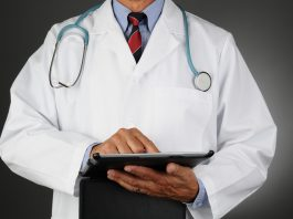 a doctor analyzing his report