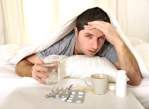 drinking medicine due to headache