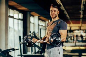 fit guy lifting weights