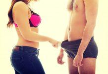 woman inspecting his member